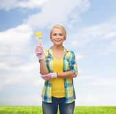Smiling woman with paintbrush — Foto Stock