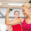 Young sporty woman with light dumbbell — Stock Photo