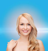 Face and shoulders of happy woman with long hair — Stock Photo