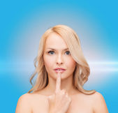 Woman touching her lips — Stock Photo