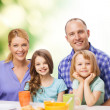 Happy family with two kids with having breakfast — Stock Photo #43711543