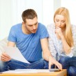Busy couple with papers and calculator at home — Stock Photo #43713715