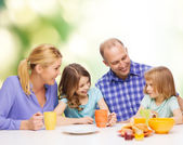 Happy family with two kids with having breakfast — Stok fotoğraf
