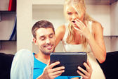 Happy couple with tablet pc computer — Stock Photo