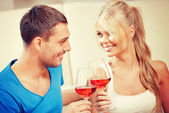 Romantic couple drinking wine — Stock Photo