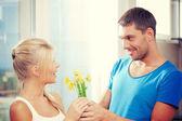 Romantic couple with flowers — Stock Photo