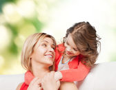 Smiling mother and daughter hugging — Стоковое фото