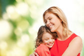 Smiling mother and daughter hugging — Stok fotoğraf