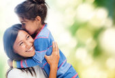 Hugging mother and daughter — Foto de Stock