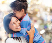 Hugging mother and daughter — Stockfoto