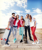 Teenagers with skates outside — Stockfoto