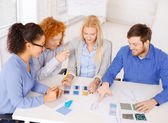 Smiling creative team looking at sketch — Stock Photo
