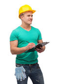 Smiling man in helmet with clipboard — Stockfoto