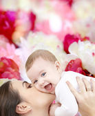 Laughing baby playing with mother — Stock Photo