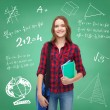 Smiling female student with bag and notebooks — Stock Photo #43970371