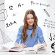 Happy smiling student girl with books — Stock Photo #43970909
