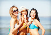 Girls in bikini with ice cream on the beach — Stok fotoğraf