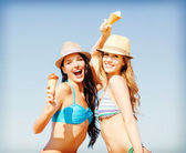 Girls in bikini with ice cream on the beach — Стоковое фото
