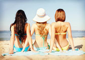 Girls sunbathing on the beach — Стоковое фото
