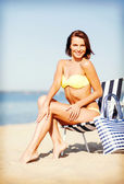 Girl sunbathing on the beach chair — Stok fotoğraf