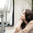 Happy and smiling woman sitting near ventilator — Stock Photo #44161941