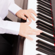 Close up of child hands playing the piano — Stock Photo