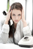 Stressed and tired businesswoman with cell phone — Стоковое фото