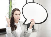 Businesswoman holding blank text bubble — Стоковое фото