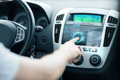 Man using car control panel — Stock Photo