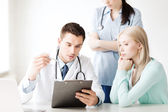 Doctor and nurse with patient in hospital — Stock Photo