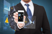 Businessman showing smartphone with virtual screen — Stockfoto
