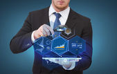 Businessman hand holding magnifier over tablet pc — Stockfoto