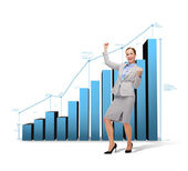 Happy businesswoman with hands up — Stock Photo