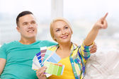 Couple looking at color samples in new home — Stock Photo