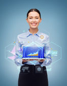 Smiling businesswoman with tablet pc computer — Stock Photo