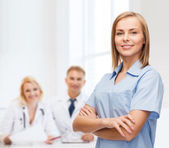 Smiling female doctor or nurse — Stockfoto