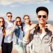 Teenage boy with sunglasses and friends outside — Stock Photo #44626963