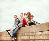 Group of teenagers hanging outside — Stock Photo