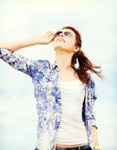 Teenage girl in shades outside — Stock Photo