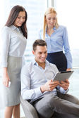 Business team working with tablet pc in office — Stockfoto