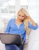 Woman with laptop computer at home — Stock Photo