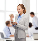Young smiling businesswoman with smartphone — Stock Photo