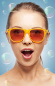 Surprised teenage girl in shades — Stock Photo