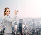Businesswoman writing something in air with marker — Stock Photo