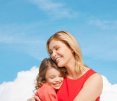 Hugging mother and daughter — Stock Photo