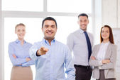 Businessman in office pointing finger at you — Foto Stock