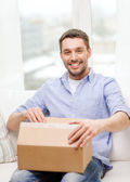 Man with cardboard boxes at home — Stock Photo
