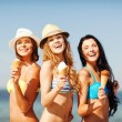 Girls in bikinis with ice cream on the beach — Stock Photo #45104849