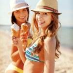 Girls in bikinis with ice cream on the beach — Stock Photo #45105853