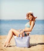 Girl sunbathing on the beach chair — Stock Photo